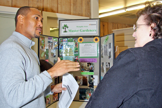 Dr. Cooper discussing the Master Gardener program to a potential candidate