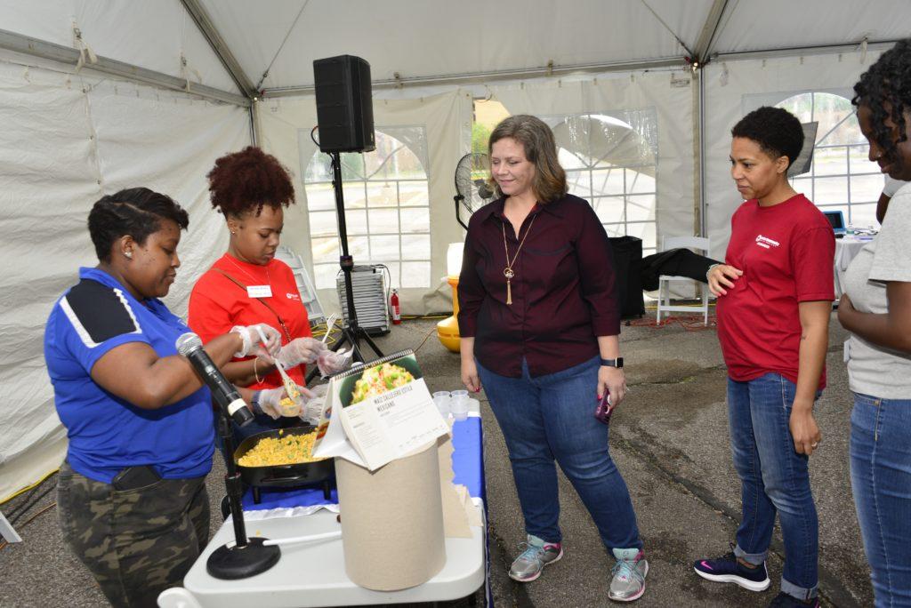 Kids and volunteer talking